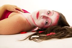 Mime with make up. Woman mime with white and pink make up lying on back Royalty Free Stock Photos