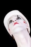 Mime no chapéu branco isolado no fundo preto fotografia de stock