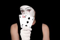 Mime with playing cards on  black background Stock Photo