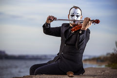 Mime playing violin outdoors Royalty Free Stock Image