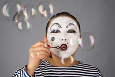Mime portrait blowing bubbles Stock Photos