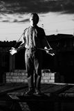 Mime posing on the roof of the house night stock image