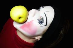 Mime que morde uma maçã Imagem de Stock Royalty Free