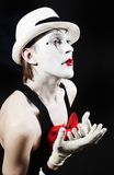 Mime with red bow ina white hat and striped gloves Stock Photography