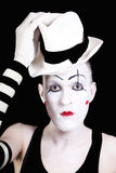 Mime with red bow ina white hat and striped gloves Stock Images