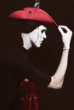 Mime in a red cowboy hat Stock Photos