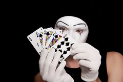 Mime with royal flush on a black background Royalty Free Stock Photography