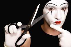 Mime with scissors on  black background Stock Images