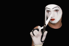 Mime with scissors on  black background Stock Image