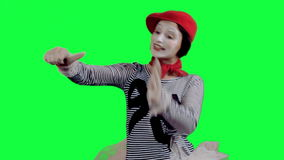 The mime showing thumbs up. The girl mime against a green background stock footage