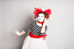 Mime with smartphone. Concept of  April Fools Day. Stock Photo