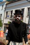 Mime on the street in a black hat Stock Photography