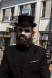 Mime on the street in a black hat Stock Images