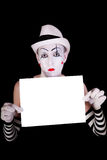 Mime in striped gloves  holding white blank Royalty Free Stock Image