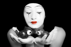 Mime with toy birds Stock Photography
