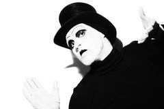 Mime wearing a black top-hat Stock Photography