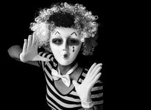 Mime wearing mask and clown wig. Scary mime wearing mask and clown wig Royalty Free Stock Photography