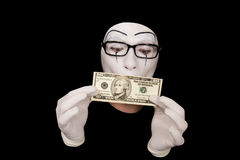Mime in white gloves  with 10 dollar denomination Royalty Free Stock Photos