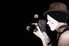 Mime in white gloves and brown hat with camera Royalty Free Stock Photography