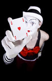 Mime in white hat showing ace of hearts Stock Photo