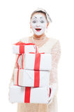 Mime woman  holding many boxes of presents Royalty Free Stock Photos