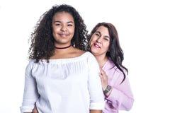 Mime y su hija adolescente aislada en blanco Fotos de archivo