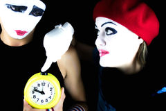 Mimes and alarm clock Royalty Free Stock Image