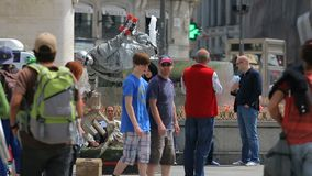 Mimes on square Puerta del Sol entertain public in Madrid, Spain. People walking around at sunny summer day stock video