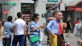 Mimes on square Puerta del Sol entertain public in Madrid, Spain. People walking around at sunny summer day stock video footage