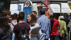Mimes on square Puerta del Sol entertain public in Madrid, Spain. People walking around at sunny summer day near exit from metro station stock footage