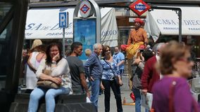 Mimes on square Puerta del Sol entertain public in Madrid, Spain. People walking around at sunny summer day near exit from metro station stock video footage