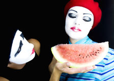 Mimes and a water-melon Royalty Free Stock Image