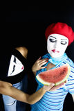 Mimes and a water-melon Royalty Free Stock Images