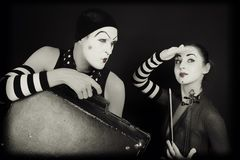 Mimes woman and man with suitcase and violin Royalty Free Stock Photography