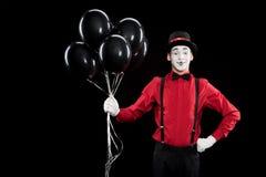 mimicar guardando o pacote de balões pretos fotografia de stock royalty free