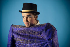 Mimics an actor. Portrait of an actor dressed in a jacket on his back before Royalty Free Stock Photo