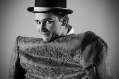 Mimics an actor. Portrait of an actor dressed in a jacket on his back before Stock Image