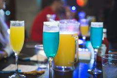 Mimosa Brunch blue and yellow drinks with icing stock image
