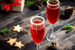 Mimosa cocktail for Christmas. Mimosa festive drink for Christmas - champagne red cocktail Mimosa with cranberry for Christmas party, copy space royalty free stock photography