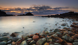 Mimosa Rocks Dawn. A long exposure dawn shot of first light at Mimosa Rocks in Mimosa Rocks National Park at Aragunnu.  A feature of this beach is its colourful Royalty Free Stock Photography