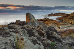 Mimosa Rocks. Sunrise skies at Mimosa Rocks, Mimosa Rocks National Park. Various rocks and geological formations as well as aboriginal middens exist and are royalty free stock photo