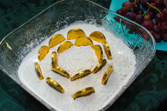 Mimouna. Gold coins in flour symbolize good wishes for prosperity in the upcoming year, tradition of the Mimouna, a sephardic Moroccan Jewish custom at the end Stock Photography