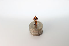 The min busines sman standing on money. Min busines sman standing on money Royalty Free Stock Photos