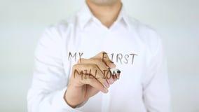 Min första miljon, manhandstil på exponeringsglas Arkivbild
