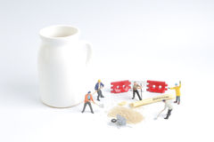 Min toy worker work with the sugar Stock Photography