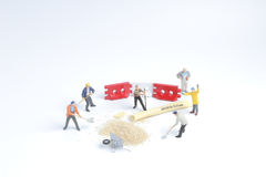 Min toy worker work with sugar Royalty Free Stock Photography