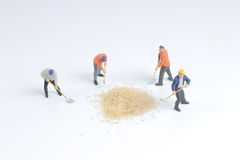 Min toy worker work with the sugar Royalty Free Stock Photos