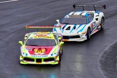 Min Xiao die Tiger Wu rennen bij Ferrari-ras het Van Azië en de Stille Oceaan van de Uitdagingsreeks Royalty-vrije Stock Foto's