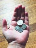 Mina sista få mynt royaltyfria foton