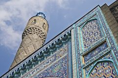 Minaret. The minaret and the front wall with Arabic mosaics of the ancient mosque in Saint Petersburg, Russia stock photography